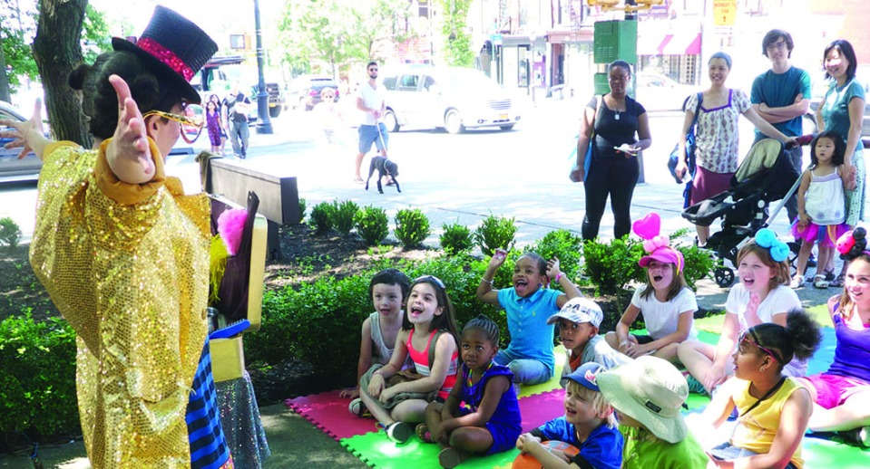 NYC magician Razzle Dazzle entertains kids at Atlantic Antic Festival, Brooklyn