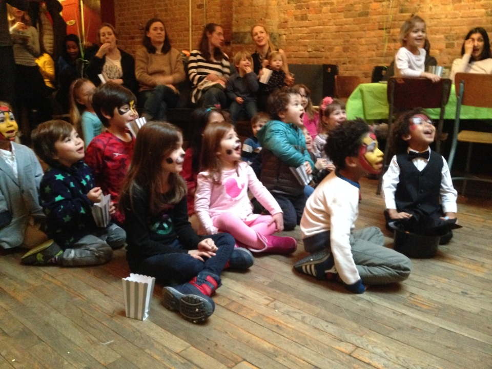 Kids watching NYC magician Razzle Dazzle
